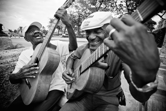 Two men play guitar in Old Havana, Cuba.